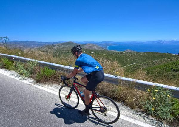 Climbing on Mt. Penteli. The view of the sea is the perfect company of the way up - Road Cycling in Athens by GrCycling